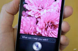 Siri, the new virtual assistant, is displayed on the new Apple iPhone 4S in San Francisco, California, Oct. 10, 2011.