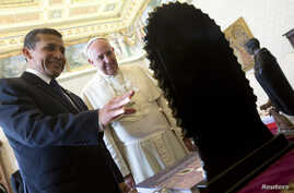 FILE - Pope Francis exchanges gifts with Peru's President Ollanta Humala during a private audience at the Vatican, November 14,  2014.