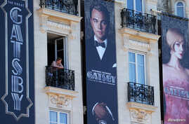 Posters for the film 'The Great Gatsby' showing actor Leonardo DiCaprio (C) and actress Carey Mulligan (R) are displayed outside the Carlton Hotel before the start of the 66th Cannes Film Festival in Cannes, May 13, 2013.