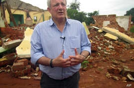 U.N. humanitarian chief Stephen O'Brien answers reporters' questions during an organized trip to Bangassou, Central African Republic, July 18, 2017.