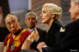 "The Dalai Lama and singer Lady Gaga appear together for a question and answer session on ""the global significance of building compassionate cities"" at the U.S. Conference of Mayors 84th Annual Meeting in Indianapolis, Indiana United States, June 26,"