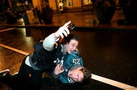 Philadelphia Eagles football fans celebrate their Super Bowl LII victory over the New England Patriots in downtown Philadelphia, Pennsylvania, U.S., Feb. 4, 2018.