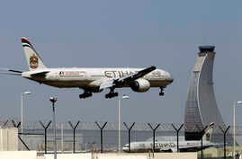 FILE - An Etihad Airways plane prepares to land at the Abu Dhabi airport in the United Arab Emirates, May 4, 2014.