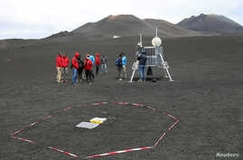 Scientists from German Aerospace Center are seen working as they test some robots on the Mount Etna, Italy, July 2, 2017.