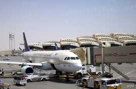A Saudi Arabian Airlines A320 is parked at the King Khalid International Airport, Riyadh, Saudi Arabia. The Saudi military intercepted a ballistic missile fired from Yemen, Nov. 3, 2017, that was aimed at the airport.