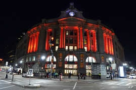 South Station is illuminated red to raise awareness for the bleeding disorders community on World Hemophilia Day, April 17, 2016, in Boston. A new gene therapy is offering hope for a cure for hemophilia.