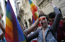 FILE - Participants of a Gay Pride event in support of  Lesbian, Gay, Bisexual and Transsexual (LGBT) rights, chant slogans after police dispersed them, in Istanbul, June 28, 2015.