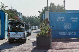 FILE - Peacekeepers serving in the United Nations Organization Stabilization Mission in the Democratic Republic of the Congo (MONUSCO) drive into their compound after patrolling the streets during mass protests against President Joseph Kabila in the