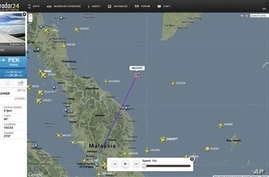 This screengrab from flightradar24.com shows the last reported position of Malaysian Airlines flight MH370, Friday night March 7, 2014. The Boeing 777-200 carrying 239 people lost contact over the South China Sea on a flight from Kuala Lumpur to Beij