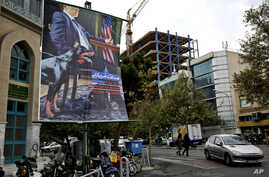 A poster depicting an American negotiator wearing a suit jacket and tie at a negotiating table and a dog to his side is displayed in Palestine square, Tehran, Iran, Oct. 27, 2013.