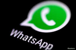 The WhatsApp messaging application is seen on a phone screen