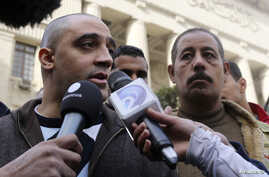 Adel, the brother of Canadian-Egyptian Mohamed Fahmy, one of the journalists working for Al Jazeera television, speaks to the media in front of a court in Cairo, January 1, 2015.