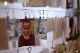 Photographs of child victims are displayed at the Kigali Memorial Center which documents the 1994 genocide, in Kigali, Rwanda, Feb. 19, 2008.