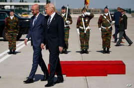 President Donald Trump walks with Belgian Prime Minister Charles Michel during an arrival ceremony at Brussels International Airport, May 24, 2017, in Brussels.