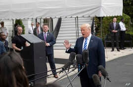 President Donald Trump talks to the media at the White House as he leaves for Dallas to address the National Rifle Association, May 4, 2018 in Washington.