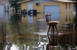 A stool sits in the middle of a roadway in floodwaters in the aftermath of Hurricane Florence in Nichols, S.C., Friday, Sept. 21, 2018.