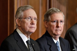 FILE -  Senate Majority Leader, Democrat Harry Reid of Nevada, and Senate Minority Leader and Republican Mitch McConnell of Kentucky, right,.