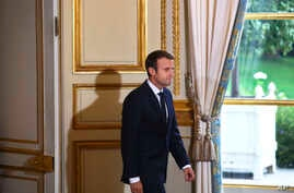 France's President Emmanuel Macron arrives to give a press conference with Australian Prime Minister Malcolm Turnbull, at the Elysee Palace, in Paris, Saturday, July 8, 2017.