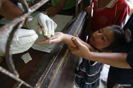 Children living in the Thai-Burma border come to a malaria clinic to get tested in Sai Yoke district, Kanchanaburi Province, October 26, 2012.