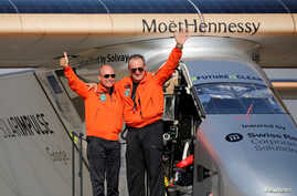 Andre Borschberg (R), the Swiss pilot of Solar Impulse 2, is greeted by fellow pilot and countryman Bertrand Piccard after landing at Cairo Airport, Egypt, July 13, 2016.