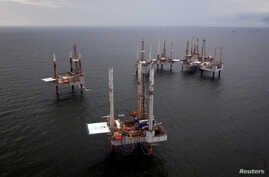 FILE - Oil rigs sit in the Gulf of Mexico, Aug. 11, 2010.