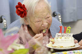 Japanese Misao Okawa, the world's oldest woman, eats her birthday cake as she celebrates her 116th birthday in Osaka, western Japan, in this photo taken by Kyodo March 5, 2014. Okawa celebrated her 116th birthday on Wednesday.