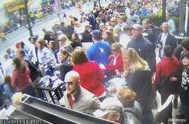 A still image captured from surveillance video at the Boston Marathon shows the scene moments before a second bomb exploded as a man, marked with a circle by prosecutors (top R) and identified by them as defendant Dzhokhar Tsarnaev, moves rapidly awa