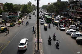 Few vehicles are seen plying on the otherwise severely busy Mehrauli Badarpur road during rush hour in New Delhi, India, Friday, April 15, 2016.