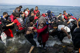Refugees arrive on a dinghy after crossing from Turkey to Lesbos island, Greece, Sept. 8, 2015.