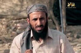 FILE -  AQAP chief Nasir al-Wuhayshi allegedly addressing scores of jihadists at an undisclosed location in Yemen.
