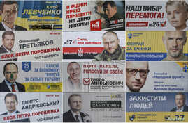 A combination photo shows pre-election posters as they are seen on the streets of Kyiv, Oct. 22, 2014. Ukrainians will take part in an early parliamentary election on October 26.