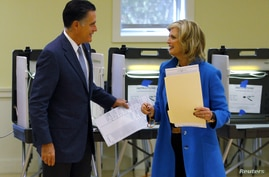 Republican presidential nominee Mitt Romney and his wife Ann finish filling out their ballots while voting during the U.S. presidential election in Belmont, Massachusetts November 6, 2012.