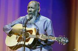 FILE - In this May 1, 2008 file photo, Richie Havens plays at the opening night ceremony during the 61st International film festival in Cannes, southern France.
