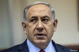 Israel's Prime Minister Benjamin Netanyahu attends the weekly cabinet meeting at his office in Jerusalem, Dec. 14, 2014.