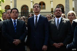 The new president of Venezuela's National Assembly, Juan Guaido, center, First Vice President Edgar Zambrano, left, and Second Vice President Stalin Gonzalez are pictured after the inauguration ceremony in Caracas, Jan. 5, 2019.