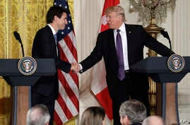 U.S. President Donald Trump, right, shakes hands with Canadian Prime Minister Justin Trudeau during their joint news conference in the East Room of the White House, Feb. 13, 2017, in Washington.
