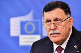Libya's Prime Minister Fayez al-Sarraj addresses the media after a meeting with European Commission President Jean-Claude Juncker and EU foreign policy chief Federica Mogherini at EU headquarters in Brussels, Belgium, Feb. 2, 2017.