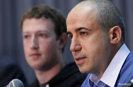 Russian entrepreneur and venture capitalist Yuri Milner (R) speaks while Facebook CEO Mark Zuckerberg looks on at the Life Sciences Breakthrough Prize announcement in San Francisco, California, February 20, 2013.