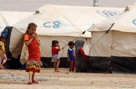 Displaced children, who fled from the Islamic State violence, gather at a refugee camp in the Makhmour area near Mosul, Iraq, June 17, 2016. Picture taken June, 17 2016.