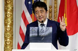 Japan's Prime Minister Shinzo Abe delivers his keynote speech on Japan's economy and investment-friendly reforms, at the New York Stock Exchange, Sept. 20, 2017.