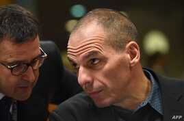 Greece's Finance Minister Yanis Varoufakis (R) speaks with a Greek delegation member an economic and financial affairs council (ECOFIN) at the European Council in Brussels, March 10, 2015.