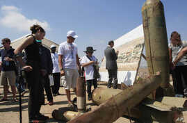 Activists and international delegations look at cluster bomb units, during a visit to a Lebanese military base at the opening of the Second Meeting of States Parties to the Convention on Cluster Munitions, in the southern town of Nabatiyeh, Lebanon,