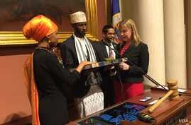 Ilhan Omar takes the Oath of Office on a special Koran in a ceremony at the Minnesota State Capitol Building, Jan. 3, 2017. (K. Farabaugh/VOA)