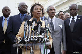 Rep. Barbara Lee, D-Calif., center, accompanied by fellow members of the Congressional Black Caucus, speaks to reporters outside the White House in Washington, following a meeting with President Barack Obama. (File Photo)