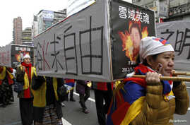 Activists carrying mock-ups of coffins to mourn for those who killed themselves in self-immolation, take part in a rally to support Tibet in Taipei. Hundreds of Tibetans and their supporters marched the streets to commemorate the uprising in Lhasa 53