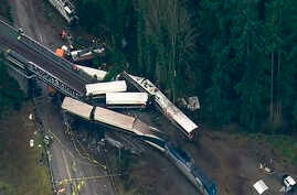 This aerial image from video provided by KOMO-TV, shows the site of an Amtrak train that derailed south of Seattle on Dec. 18, 2017.