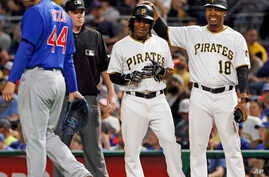 Pittsburgh Pirates' Gift Ngoepe, a native of South Africa, and the first baseball player from the continent of Africa to play in the Major Leagues celebrates with first base coach Kimera Bartee (18) after getting a single off Chicago Cubs starting pi