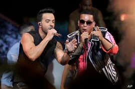 """FILE - Singers Luis Fonsi, left and Daddy Yankee perform during the Latin Billboard Awards in Coral Gables, Fla., April 27, 2017. Malaysia has banned their hit song """"Despacito"""" on state radio and television. The ban applies only to government-run rad..."""