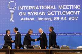 Turkish Foreign Ministry Deputy Undersecretary Sedat Onal, left, and Kazakh Foreign Minister Kairat Abdrakhmanov shake hands as Russia's special envoy on Syria Alexander Lavrentiev, center, and UN Syria envoy Staffan de Mistura shake hands and Iran's