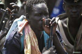 Rebel fighters listen to their commander in rebel-controlled territory in Upper Nile State, Feb. 15, 2014.